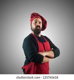 doubtful bearded chubby chef on grey background