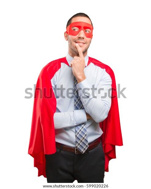 Doubtful super businessman posing