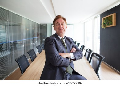 Doubting Business Leader in Conference Room