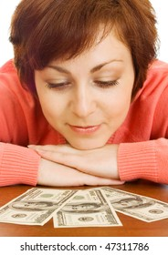 Doubting young woman with money