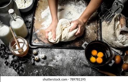 Dough background. Preparation of the dough from fresh ingredients. On a rustic background.