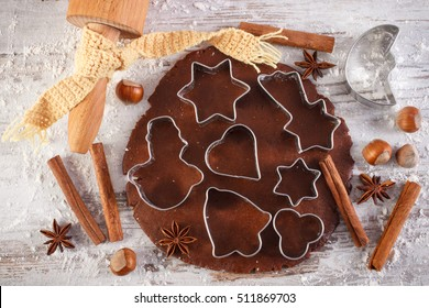 Dough for Christmas cookies with spice and ingredients for baking gingerbread on old rustic board