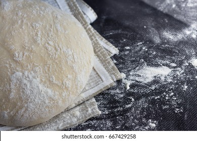 Dough Flour on black table. Culinary Concept