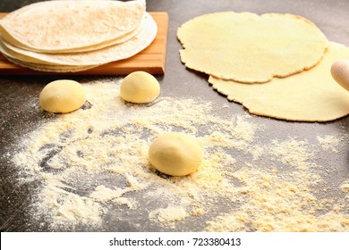 Dough for making tortillas on kitchen table