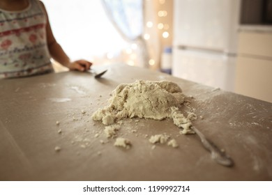 the dough is on the table, the concept is cooked with the children, the real bright kitchen and lifestyle