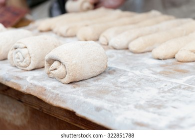 dough on wood flour ready to be introduced into the furnace