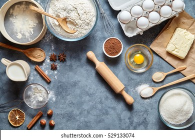 Dough preparation recipe bread, pizza, pasta or pie ingridients, food flat lay on kitchen table background. Working with butter, milk, yeast, flour, eggs, sugar pastry or bakery cooking. Text space