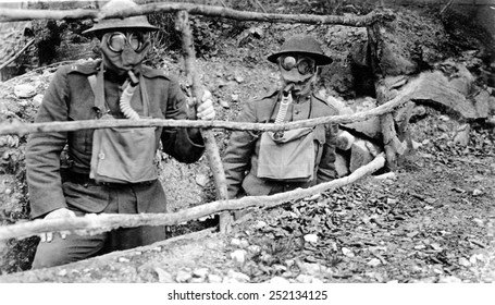 Doughboys wear gas masks in the trenches during WWI. 1918.