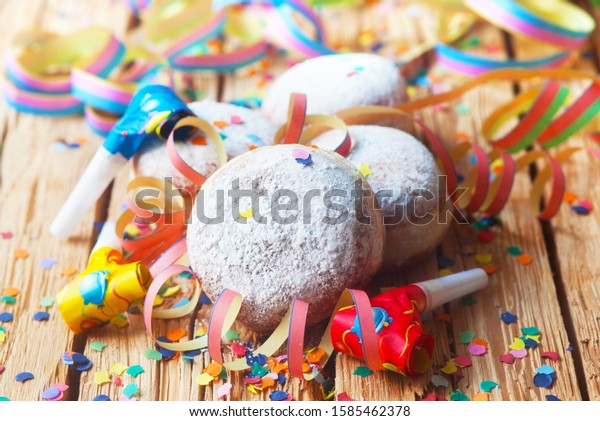 Doughnuts For Carnival On A Wooden Background