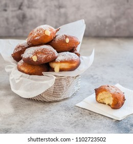Doughnuts with Creamy Lemon Filling Dusted with Icing Sugar, square