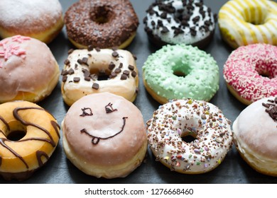 Doughnuts donuts various types of cakes abstract fat thursday concept