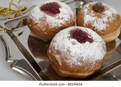 doughnuts  with jam on silver plate   for Hanukkal