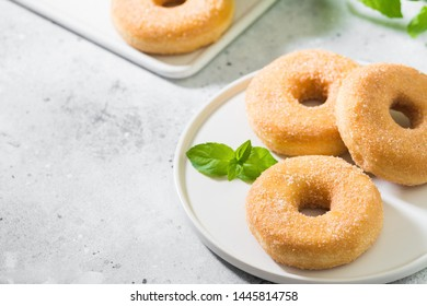 Doughnuts with sugar sprinkles. Light grey background