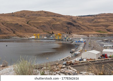 Douglas County, Washington, USA - July 12th, 2020: Wells Dam on Columbia River.  The dam, associated structures, and machinery make up the Wells Hydroelectric Project.