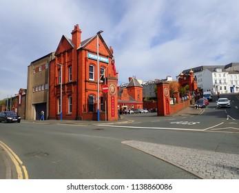 Douglas, Isle of Man, Europe, May 7, 2018. Street View of Eye-Catching Exterior of Douglas Railway Station, Terminus of the Isle of Man Steam Railway