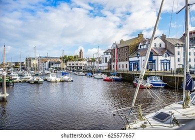 DOUGLAS, ISLE OF MAN - OCTOBER 17: Yacht docking at bay in a nice small port in a clear blue sky day in a small town of Douglas, Isle of Man. October 17, 2018.