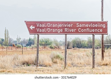 DOUGLAS, SOUTH AFRICA - AUGUST 25, 2015: Road sign pointing to the confluence of the Gariep (Orange) and Vaal Rivers near Douglas in the Northern Cape Province of South Africa.