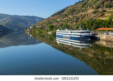 Douro, Portugal - 13 August 2020: A river cruise boat touring the Douro River in Portugal