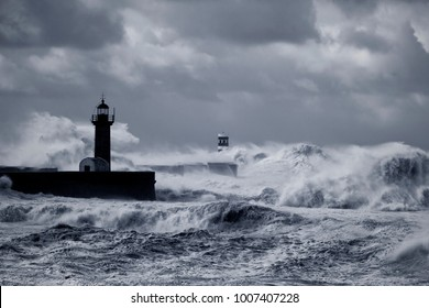 Douro river mouth under heavy storm with strong sea waves over piers and lighthouses. Converted black and white. Toned blue.