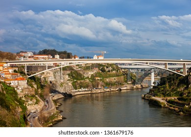 Douro river in Porto, Portugal, Infante D. Henrique Bridge with 280 meters arch span.