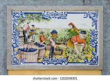 DOURO VALLEY, PORTUGAL – June 22, 2018:  Ceramic tiles depicting the grapes vintage in the Douro Valley, where the world's famous Port Wine is produced, in northern Portugal, by artist Moreira Agueda