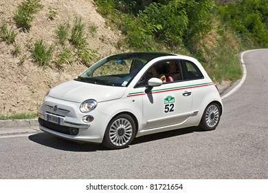 "DOVADOLA, FC, ITALY - JULY 3: unidentified drivers on Fiat 500 at ""Colline di Romagna"", historical italian rally, on July 3 2011 in Dovadola, FC, Italy"