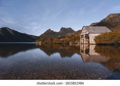 Dove Lake with boatshed against clear blue sky in the morning.