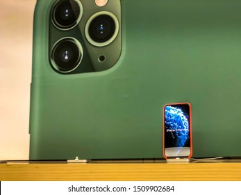 Dover, New Jersey USA - September 20th 2019: Release of the new iPhone 11 as well as iPhone 11 Pro (Max), visiting an Apple Store in USA, viewing displays showing the new iPhone with other devices