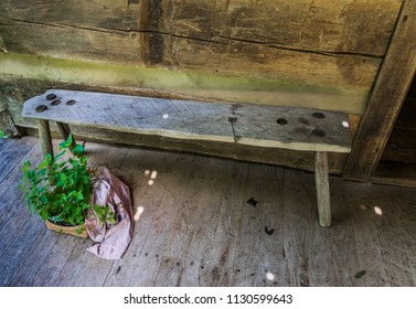 DOVER, TN, USA-30 JUNE 18: A pegged-leg bench sits on the  front porch of the main cabin at The Homeplace, an 1850s working farm and living history museum, located on The Trace road.