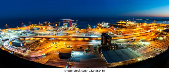 Dover, United Kingdom - February 24, 2019: Aerial panoramic view of busy Dover port terminal at night.