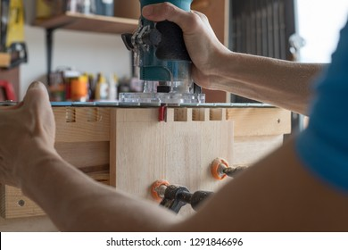 Dovetail joint make by power tool and support jig, carpenter hand, woodworking, trimmer