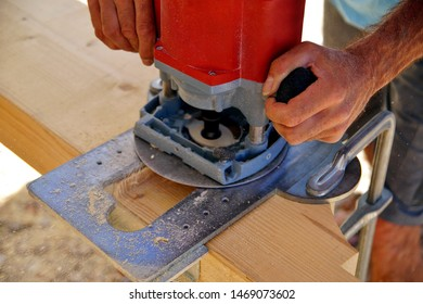 Dovetail joint. milling Woodworking and carpentry production.  a man's hands is working with a milling machine. Wooden beams spruce for outdoor construction, wood beams for carport. woodwork concept.
