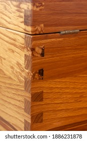 Dovetail joint on rotten beech wooden box. Dovetail joint on furniture