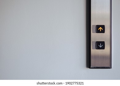 Up and down button in front of the Elevator for direction, up red light with copy space