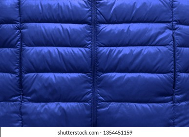 Down jacket fabric background, blue puffer jacket texture