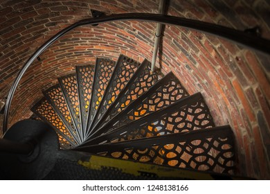 Down Metal Spiral Staircase - brick building