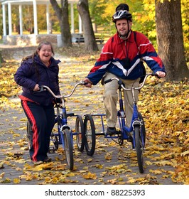 down syndrome couple on bicycles in the park