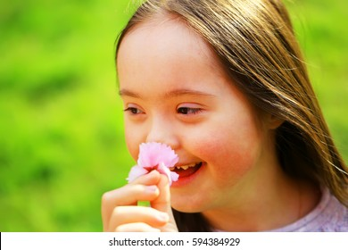 Down syndrome girl with flower