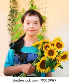 Down syndrome girl with sunflowers