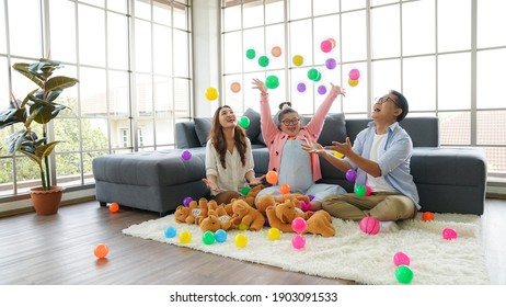 Down syndrome happy family, Parents and children throwing balls with fun.