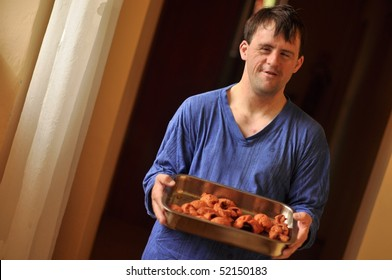 down syndrome man holding meat fillet
