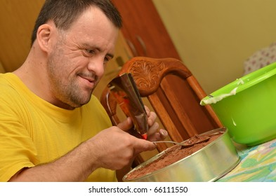 down syndrome man making pudding