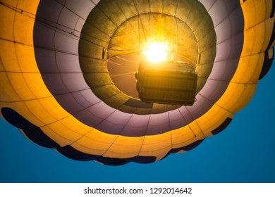 Down view on hot air balloon flying. closeup
