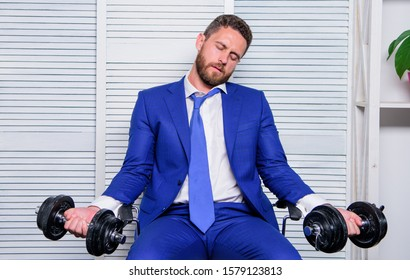 Downcast concept. Despondent by work. Feel tension in muscles. Pressure tension stress. Mental and emotional tension. Man raise heavy dumbbells. Businessman manager exhausted. Sport healthy lifestyle.