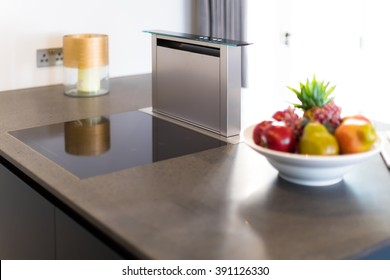 Downdraft Cooker Hood, Stainless Steel and Electronic Hob on Granit Counter-top
