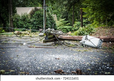 Downed power lines in street after storm.