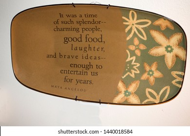 DOWNERS GROVE, ILLINOIS - NOVEMBER 11, 2016: Maya Angelou wall plaque dish celebrating charming people, good food and brave ideas.