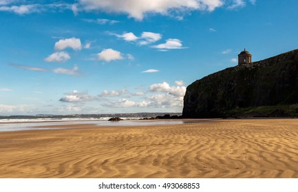 Downhill Beach with view of Mussenden Temple, Causeway Coast, County Antrim, Northern Ireland, UK.