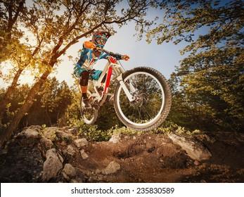 Downhill. Man riding a mountain bike. Extreme cycling.