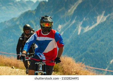 Downhill, mountain bike biker on a trail in South Tyrol, Dolomites descent.